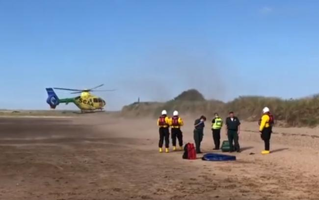 A helicopter airlifted the injured rider from the beach. Image Dunbar Coastguard