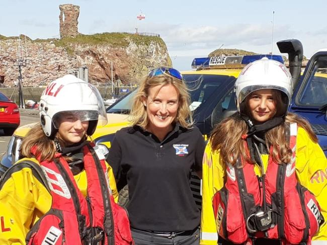 Becs Miller welcomes Charlotte Bapao and Amelie Bobes to Dunbar Lifeboat Station