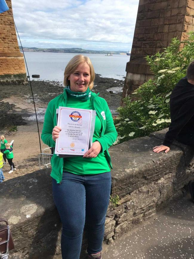Catherine Alexander back on solid ground after abseiling from the Forth Bridge