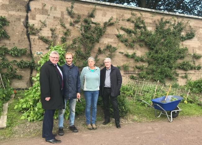Martin Whitfield MP and Iain Gray MSP, pictured with Kate Rycroft and Alasdair McDougall, stopped off at Amisfield Walled Garden