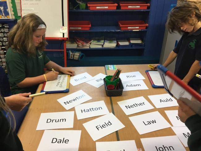 Humbie Primary School pupils working on possible names for the new town