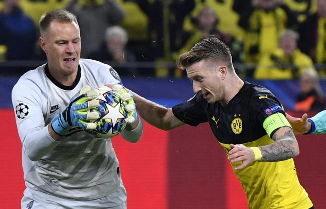 Marc-Andre ter Stegen (left) saved the penalty from Dortmund's Marco Reus (right)