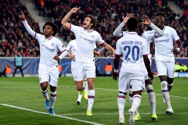 Willian, left, celebrates his winning goal at Lille