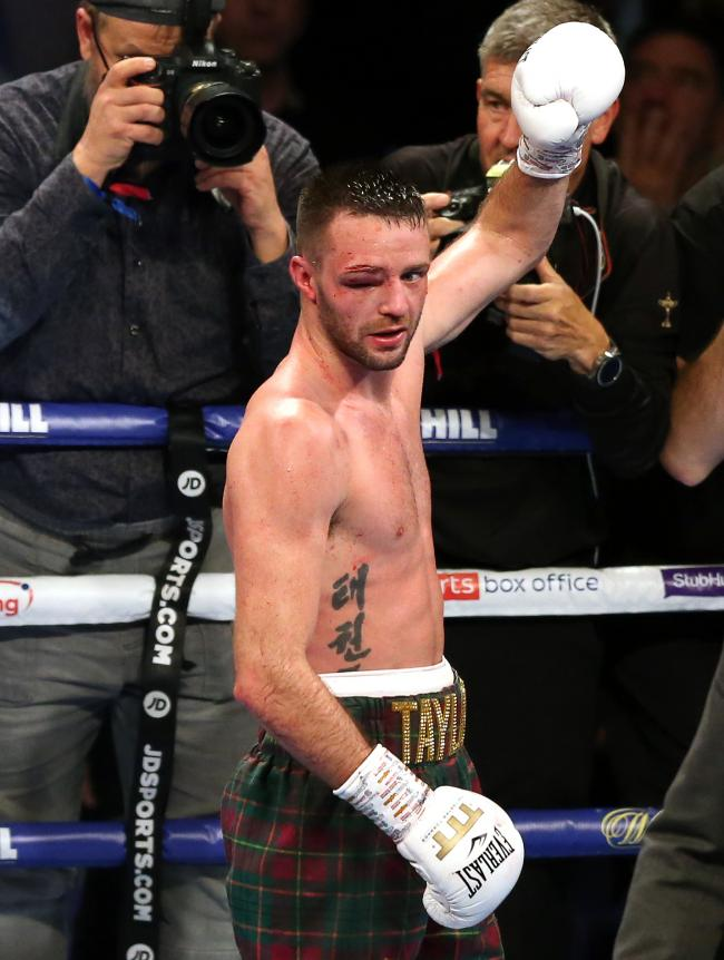 Josh Taylor celebrates winning the super-lightweight unification at the O2 Arena, London. Image: Paul Harding/PA Wire