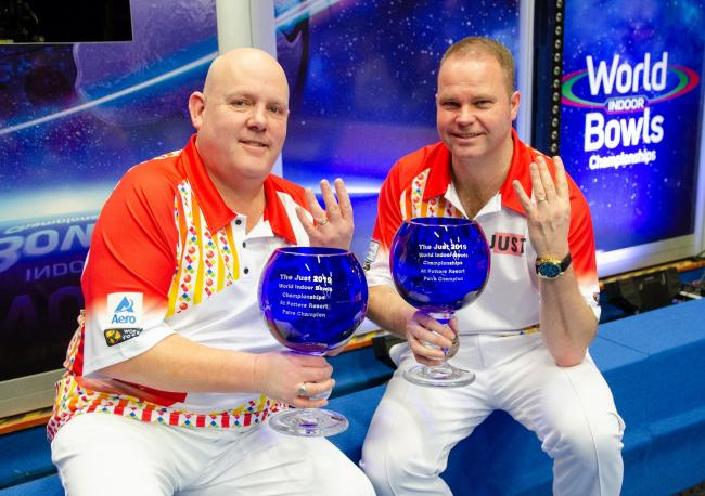 Alex Marshall and Paul Foster celebrate their fourth World Indoor Pairs title last year. Image courtesy World Bowls Tour