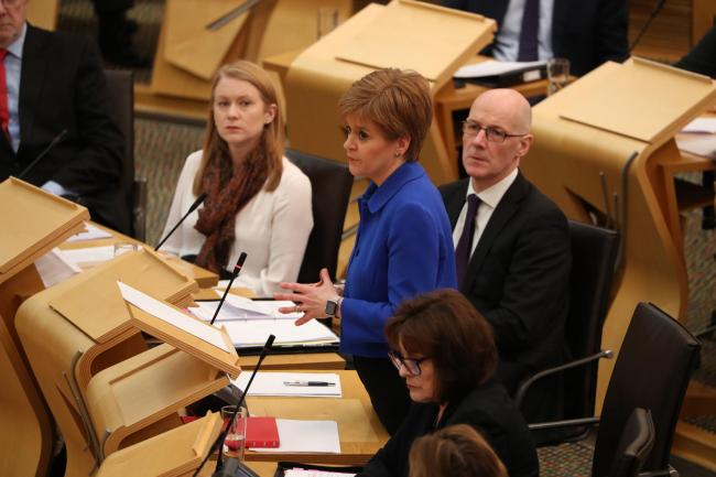 Nicola Sturgeon makes a statement in the Scottish Parliament on coronavirus on Wednesday. Image: Andrew Milligan/PA Wire