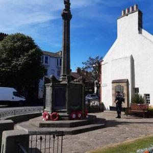 Eddie McFadzean, pipe major of North Berwick Pipe Band, marking VE Day at the war memorial in North Berwick at 3pm on 8th May. Image Eddie Clark
