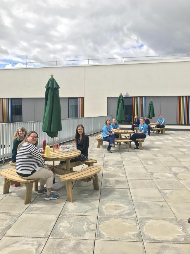 Staff utilising outdoor space (from back right): Dominic Gough, Eilidh DeClerk, Kerry Lewis, Caroline Dod, Jo Pilarska, Harriet Pritchard, Rebecca McConnell, Kirstie White and Gemma Loughrie
