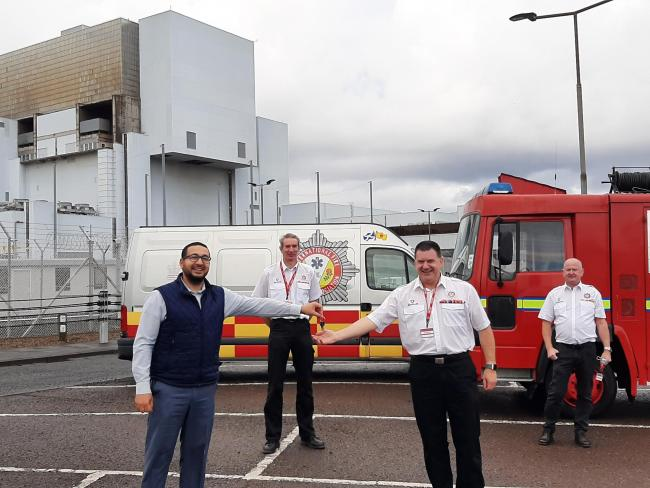 Torness Power Station director Tam Al-Bishawi hands over the keys to IFRA chairman David Kay. From left: Tam Al-Bishawi with Fraser Watson, David Kay and James Redpath, from IFRA