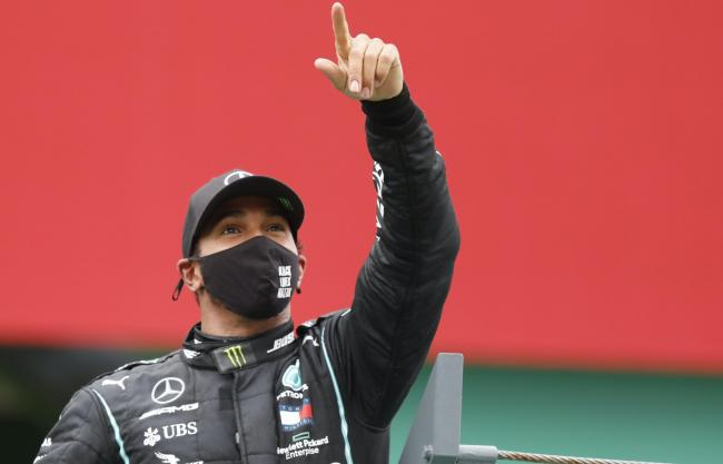Lord Hain says it is 'unacceptable' that Lewis Hamilton, pictured celebrating the Portuguese Grand Prix victory that gave him a record 92 F1 race wins, has yet to be knighted.