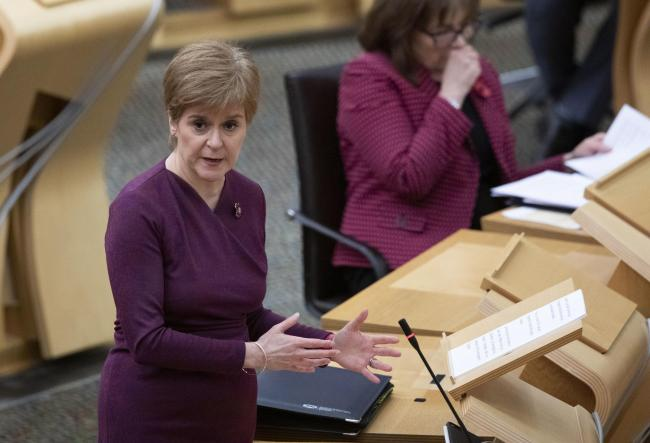 First Minister Nicola Sturgeon has been annoucing new five tier levels for local authorities in the Scottish Parliament pic Jane Barlow/PA Wire.