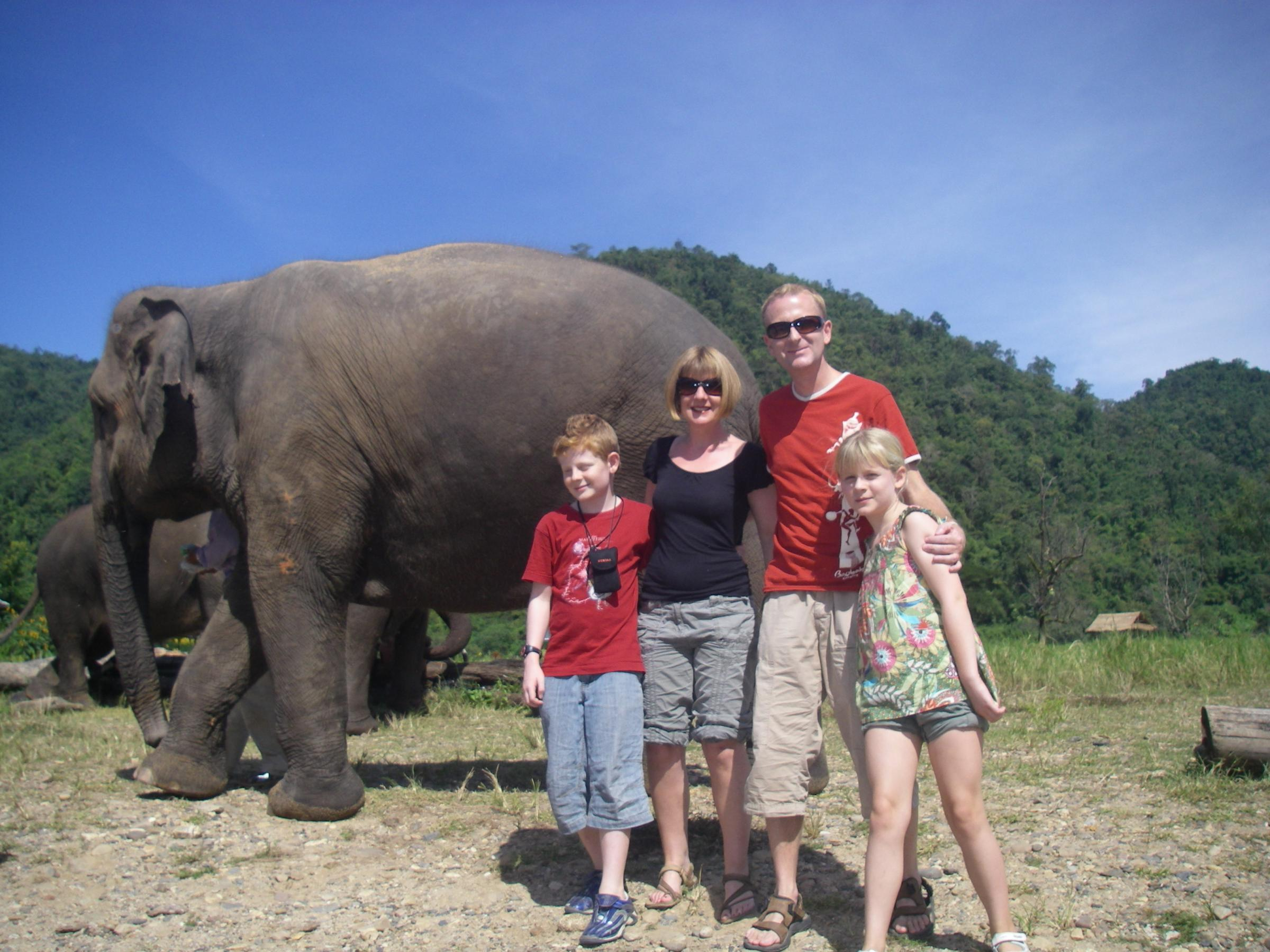 The family visited Thailand during the tour through Asia.
