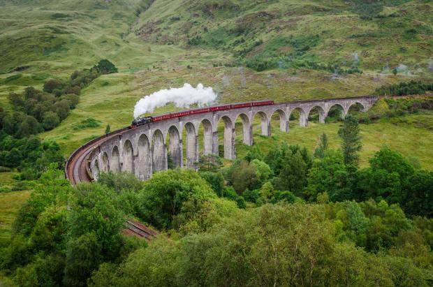 East Lothian Courier: View of a steam train on a famous Glenfinnan viaduct, Scotland; Shutterstock ID 154641122; PO: THE HERALD MAGAZINE ; Job: TRAVEL