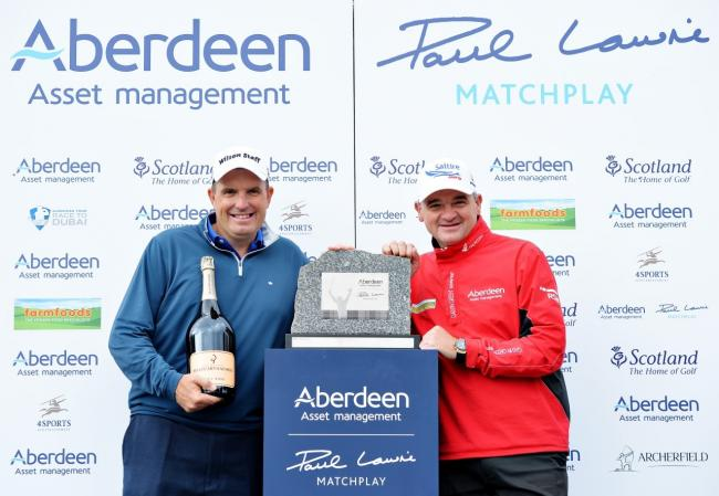 Anthony Wall (left) collects the trophy from organiser Paul Lawrie. Pic courtesy European Tour