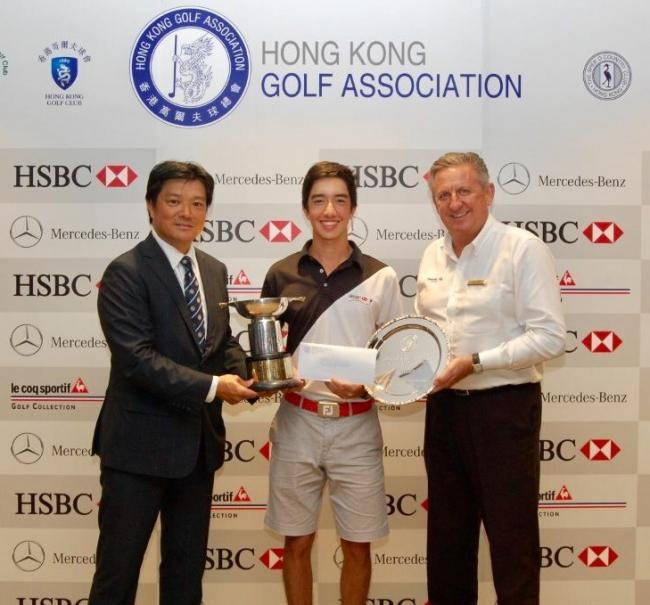 Yannick Artigolle is presented with the Hong Kong Open Amateur and Mid Amateur Championships trophy