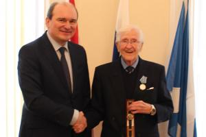 Andrey Pritsepov, the Russian Consul General in Edinburgh, presents Arctic convoy veteran George Laidlaw with his commemorative watch from Russia