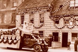 A dray lorry outside the offices of Whitelaw's Brewery decorated for the 1935 Riding of the Marches - an ancient boundary marking celebration.