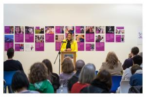 Emma Bennion addresses an audience at the launch of Autism in Focus exhibition
