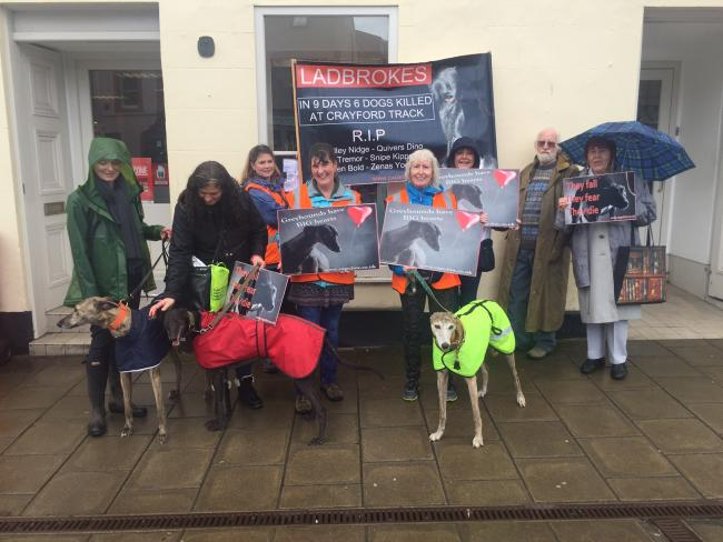 Anti-greyhound racing campaigners outside Ladbrokes in Haddington