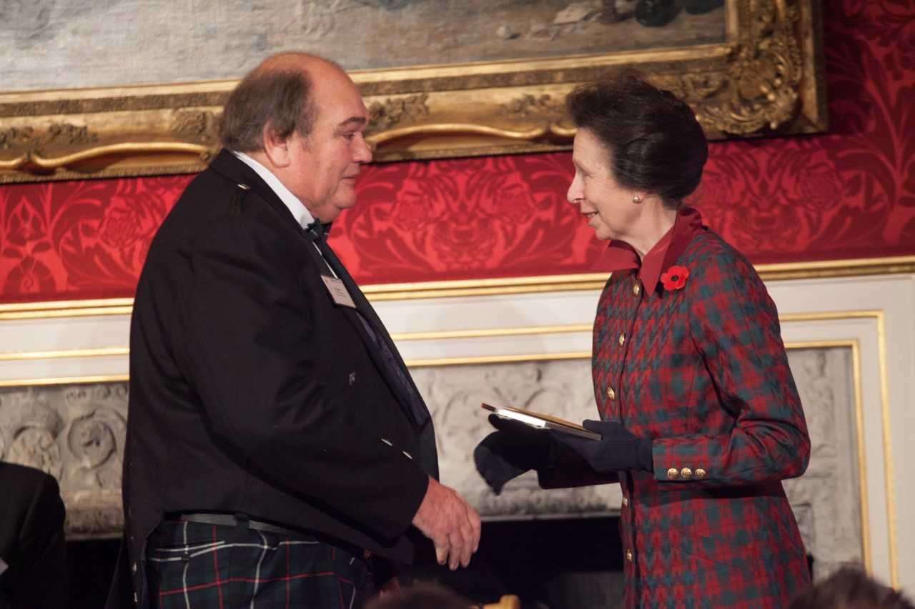Ian Robertson, station manager at East Coast FM, is presented with the award by The Princess Royal. Picture: Phil Gammon