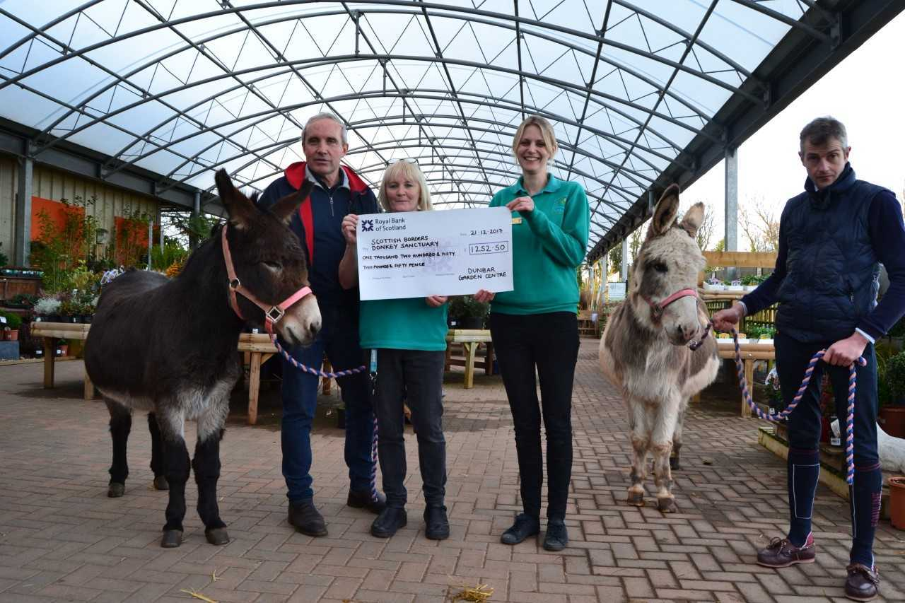 A cheque for more than £1,000 has been handed over to The Scottish Borders Donkey Sanctuary by Dunbar Garden Centre. From left: John Wilson (manager of the charity), Caroline Stewart and Annie Strang (from the garden centre) along with a volunteer and Jo