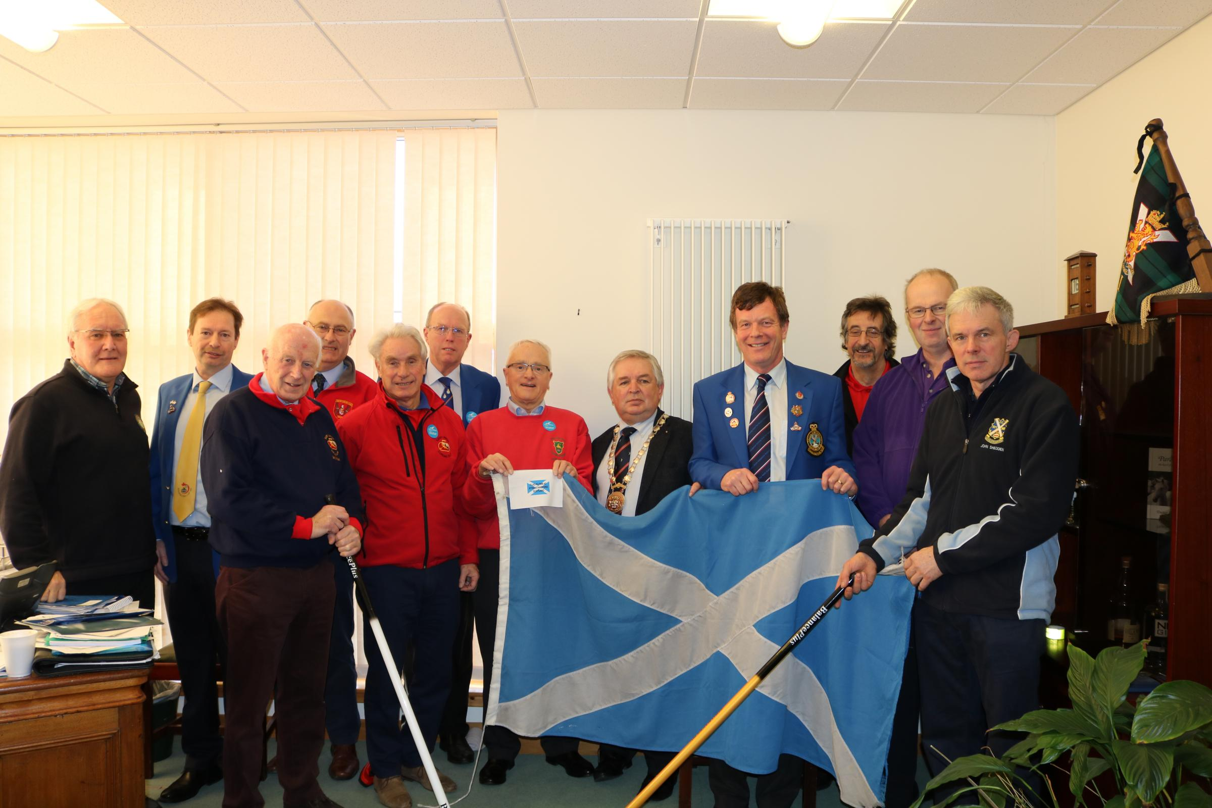 The flag is handed over by Provost John McMillan