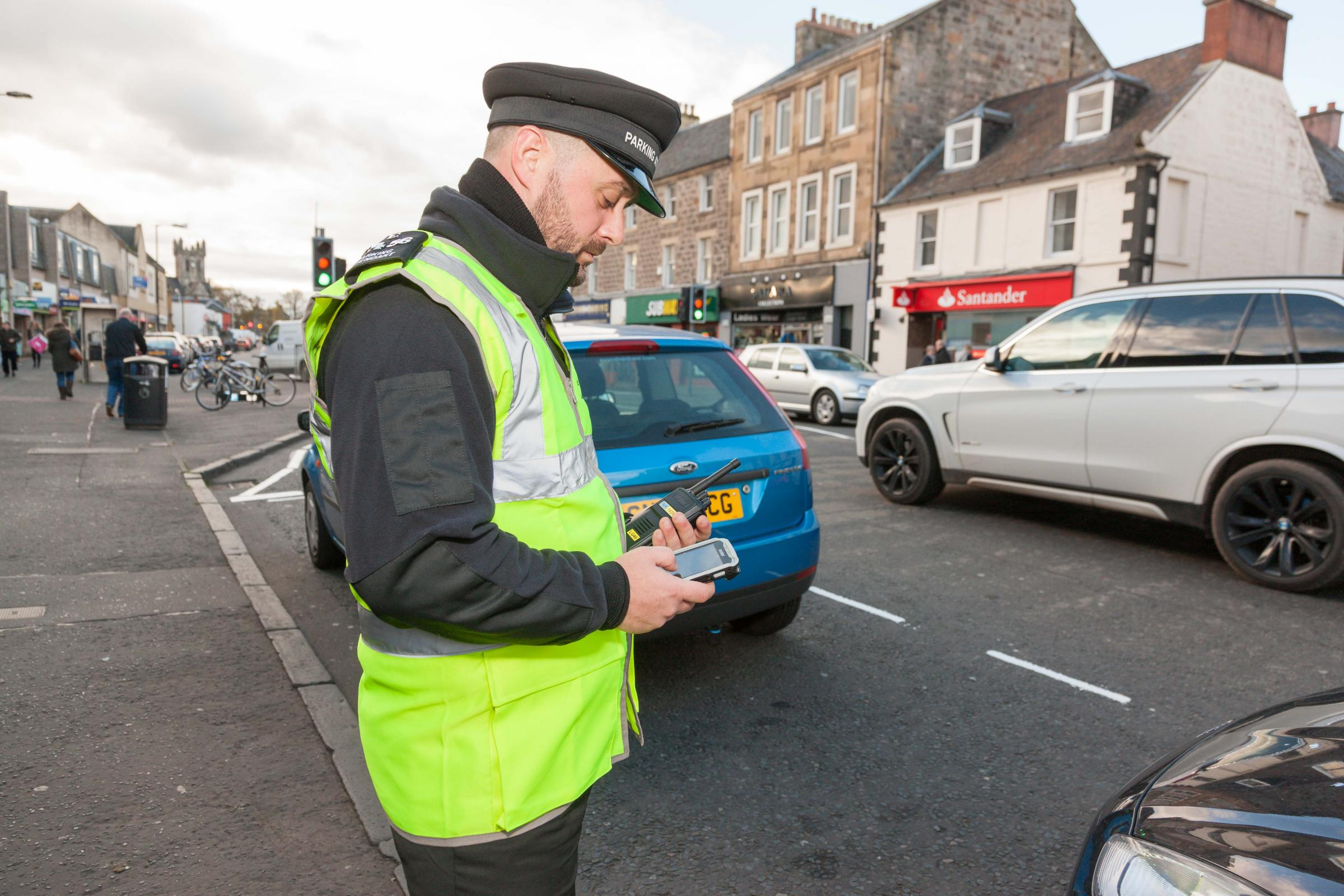 A parking attendant on patrol in Musselburgh