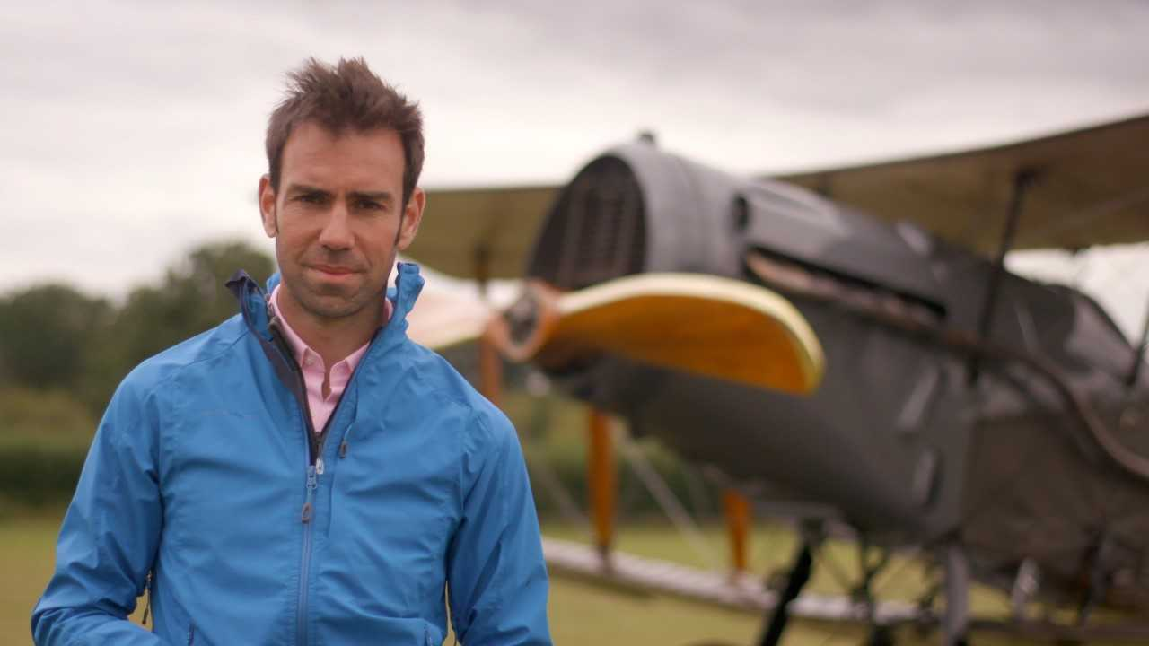 Scotland from the Sky presenter James Crawford at East Fortune airfield with a World War One bomber