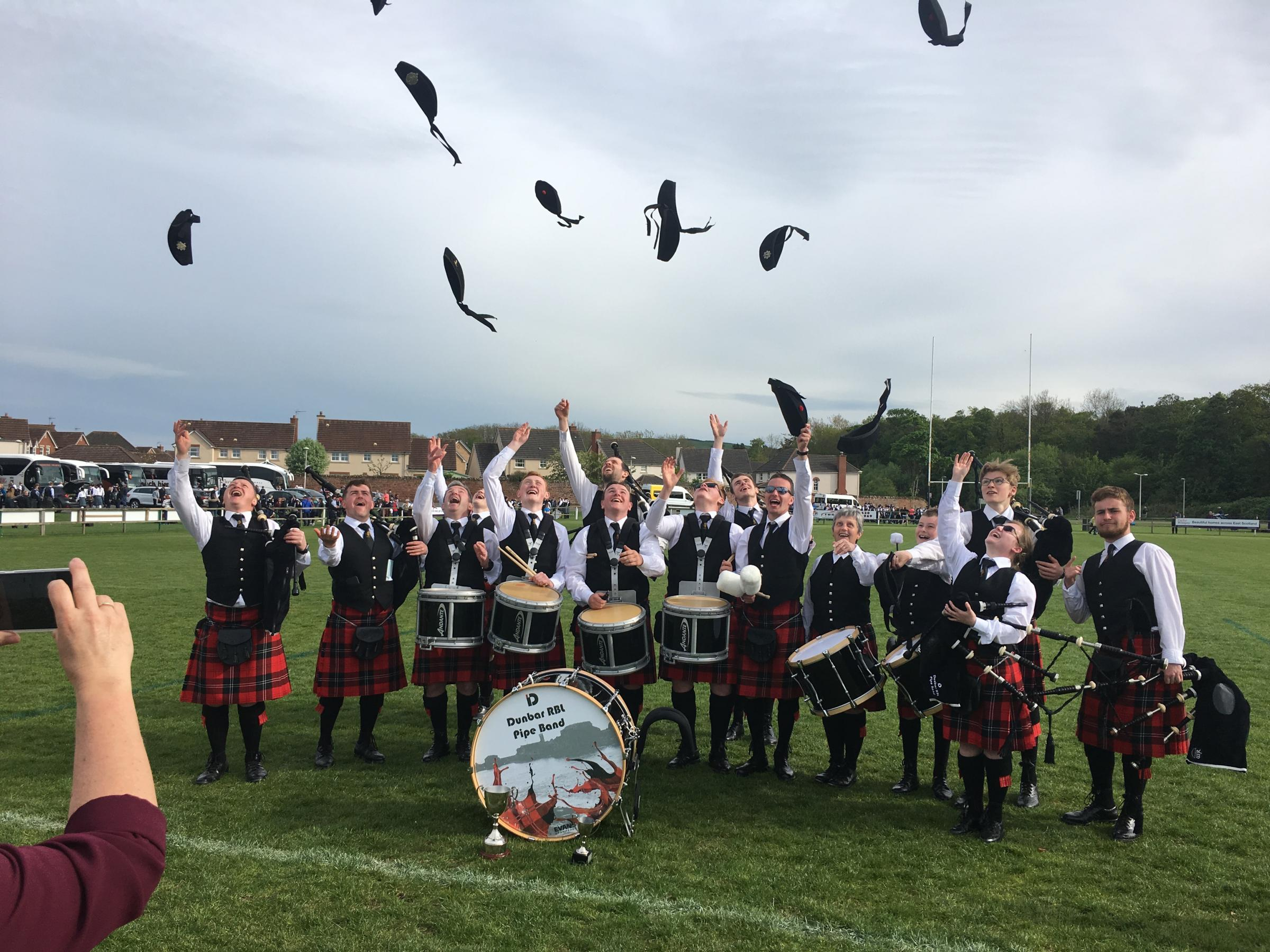Dunbar Royal British Legion Pipe Band toasted success at the Dunbar Pipe Band Championships on Saturday. Picture: Malcolm Payton