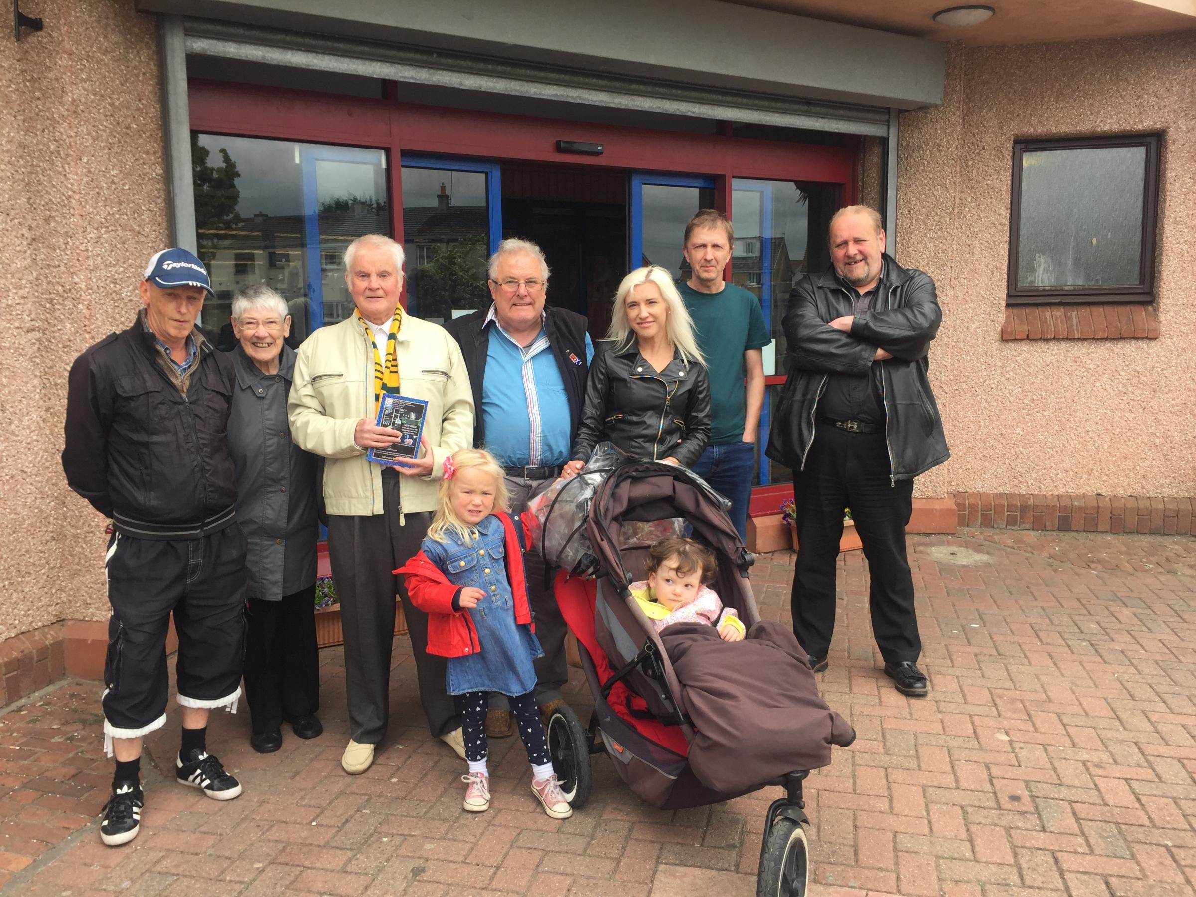 FROM LEFT: James Dixon, Jean Grant, Alexander Hood, Freddie McCreadie, Laura Bishop with Molly Hamilton and Kenzie McDonald, Eric Nisbet and Ian Donaldson outside Port Seton Library