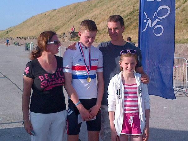 Ben Forsyth with his family after winning the British youth circuit race championship in 2013.