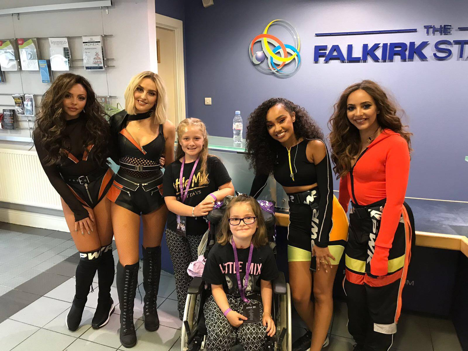 Poppy Smith (seated) and her elder sister Jessica met global superstars Little Mix