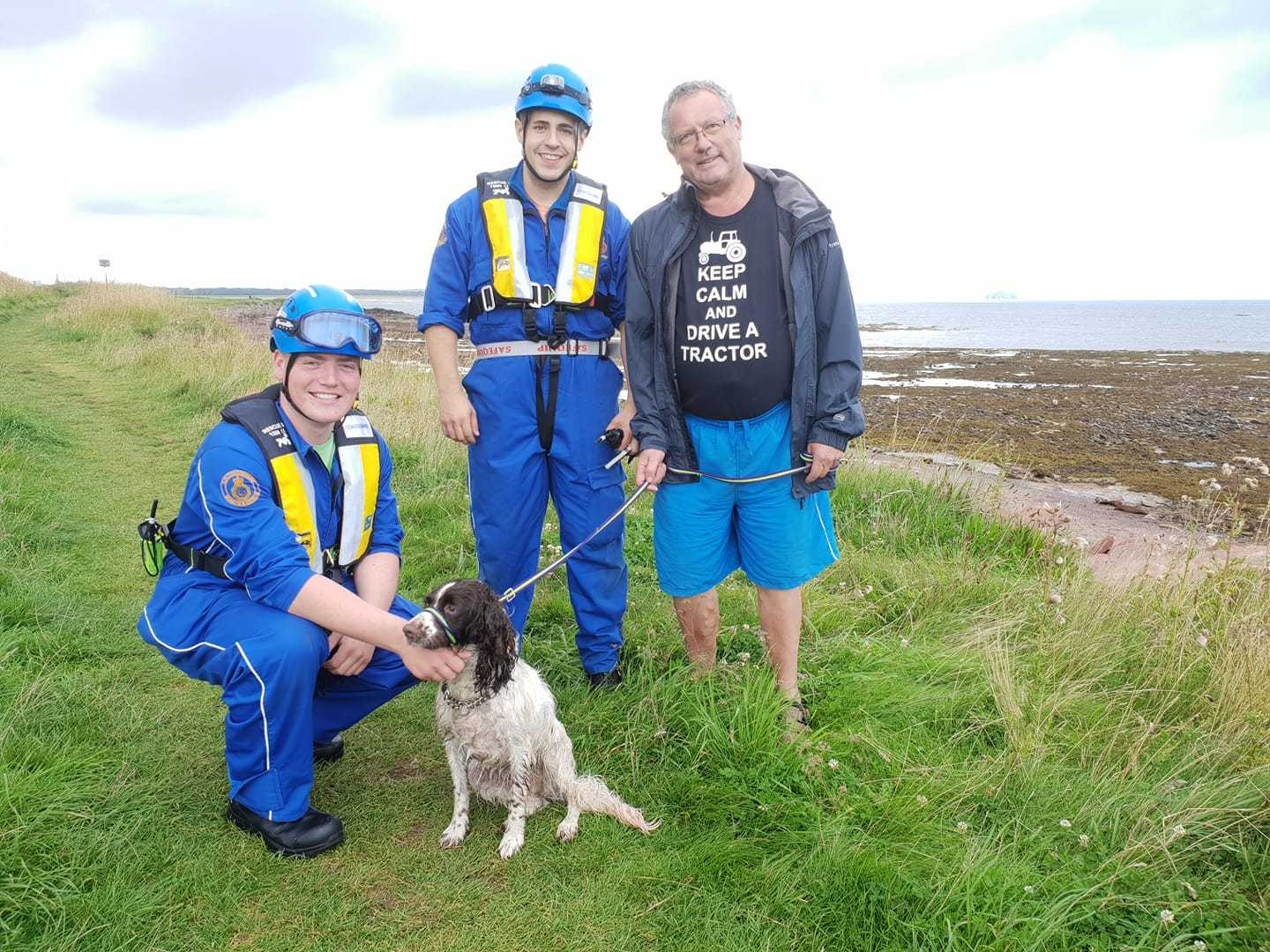 Callum Inglis and Jamie Humpage, from the Coastguard, alongside rescued Maisie. Picture: North Berwick Coastguard Rescue Team