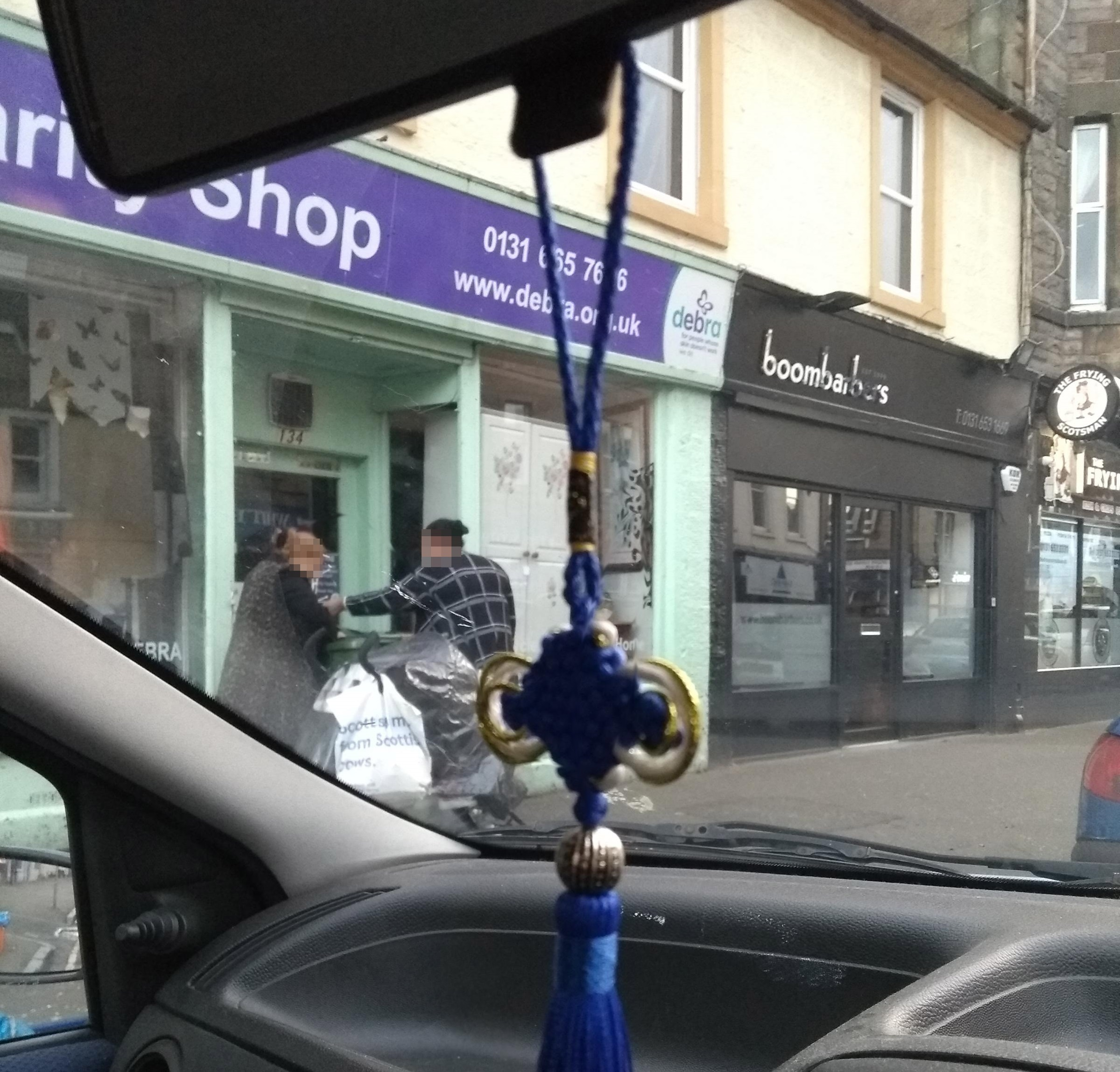 A concerned member of the public sent in a photo showing the women allegedly taking items from outside a charity shop in Musselburgh