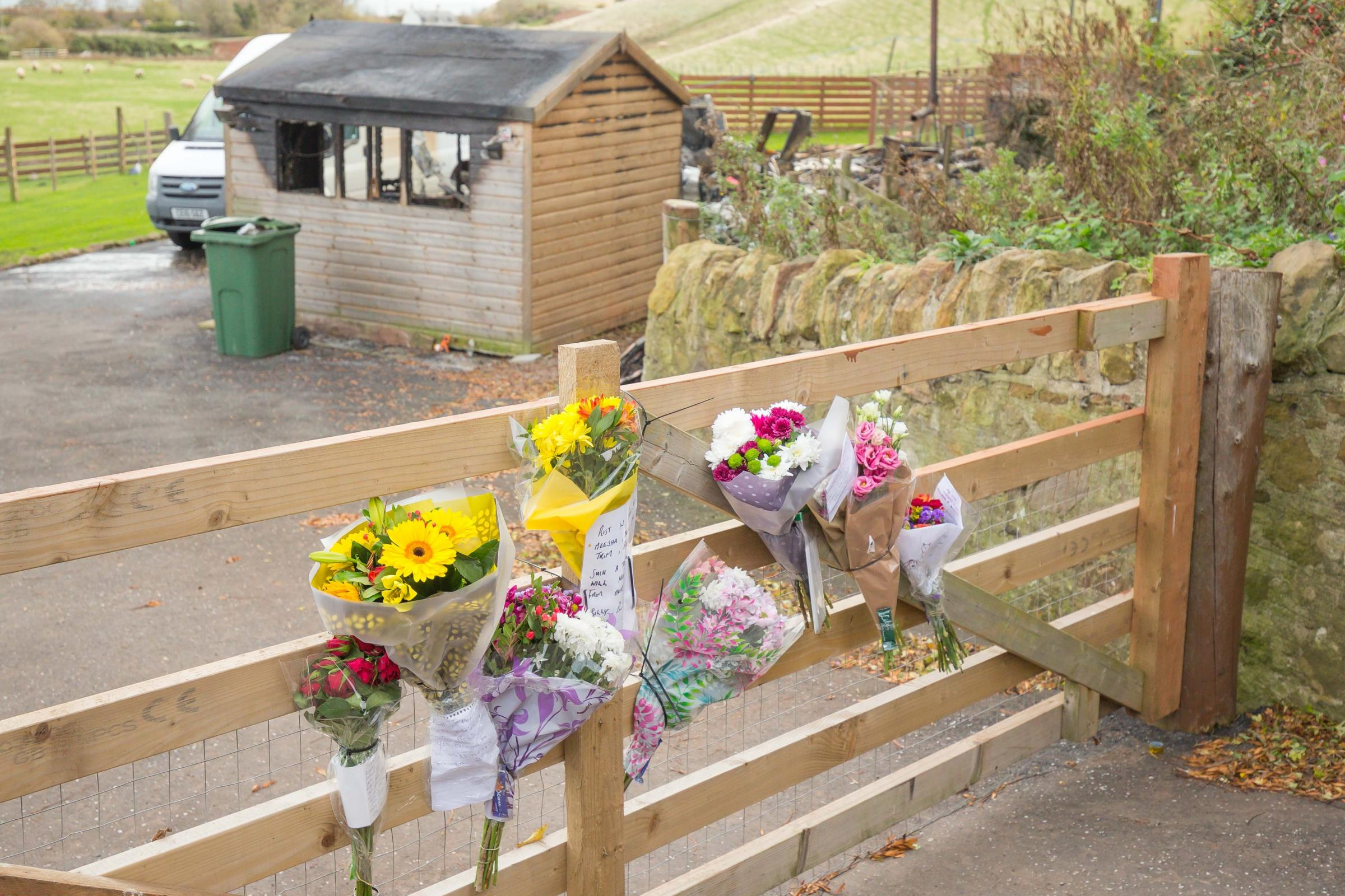 Flowers were left at the gate of Julie Melville's home following a fire in her caravan at Thornfield, near Innerwick, which claimed her life. Picture: Gordon Bell