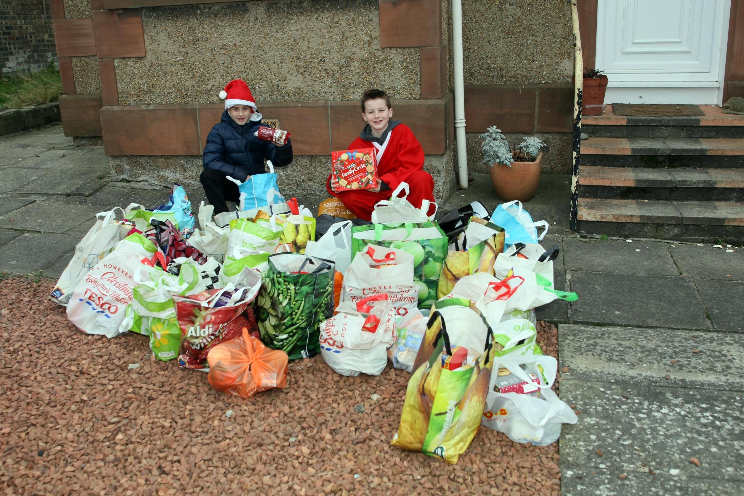 Archie Strang (right) and Lucas Leishman collected more than 100 kilogrammes of food for the East Lothian Foodbank