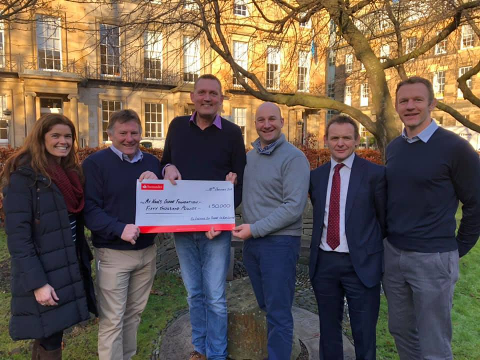 A cheque for £50,000 has been handed over to My Name'5 Doddie Foundation. From left: Lindsey Niznik, Gary Armstrong, Doddie Weir, Richard Scott, Mark Leonard and Jason White