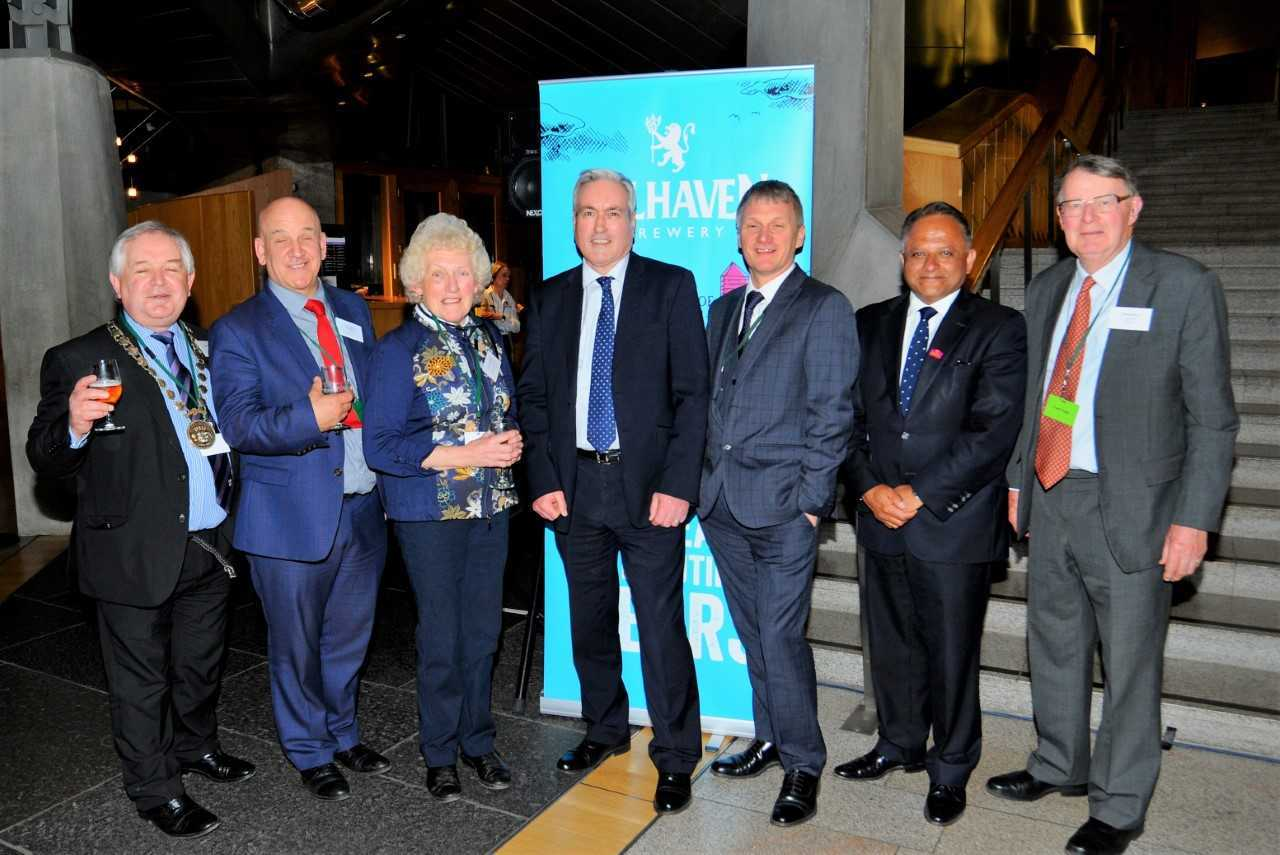 Councillor John McMillan, Councillor Norman Hampshire, Councillor Sue Kempson, Iain Gray MSP, Ivan McKee MSP, Rooney Anand (Greene King CEO), Michael Williams (Lord Lieutenant of East Lothian) toast the success of Belhaven Brewery