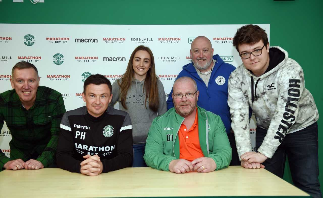 Hibs boss Paul Heckingbottom (second from left) was 'replaced' for the day, with Derek Ross (sitting beside him) taking on the role thanks to the Walk With Scott Foundation