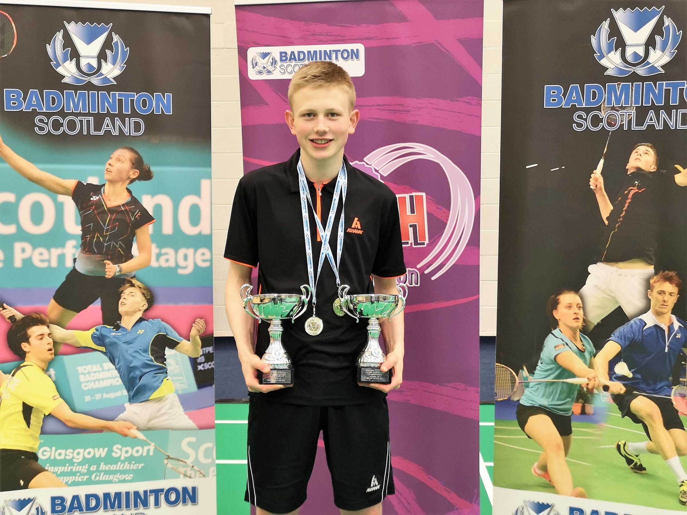 Euan Campbell was celebrating two national badminton titles