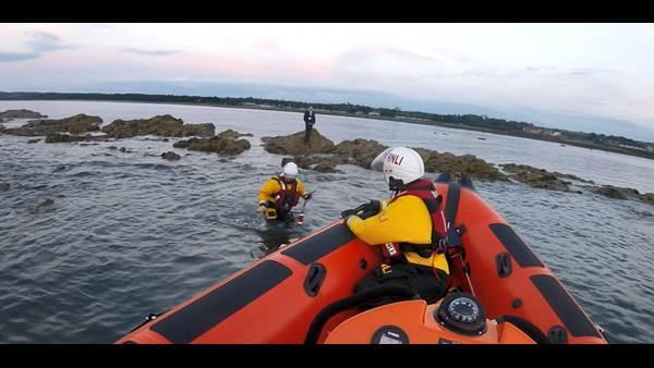 The boy being rescued from the rocks. Image Kinghorn RNLI